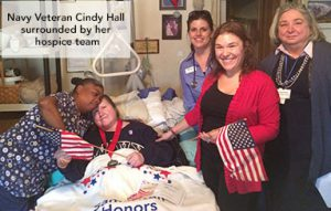 Navy veteran surrounded by hospice team