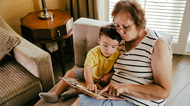 Grandmother and grandson reading