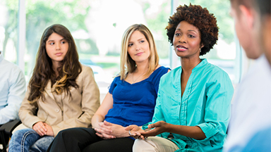 Three women chatting in grief support group