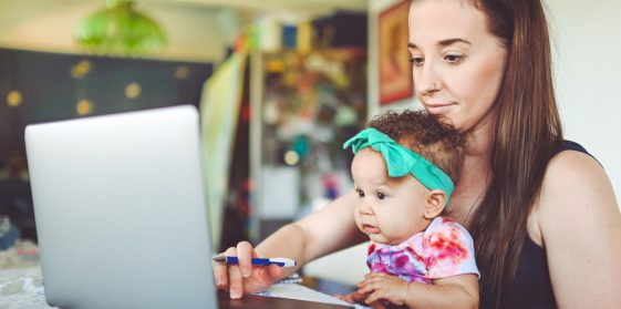 Young girl and infant video chatting