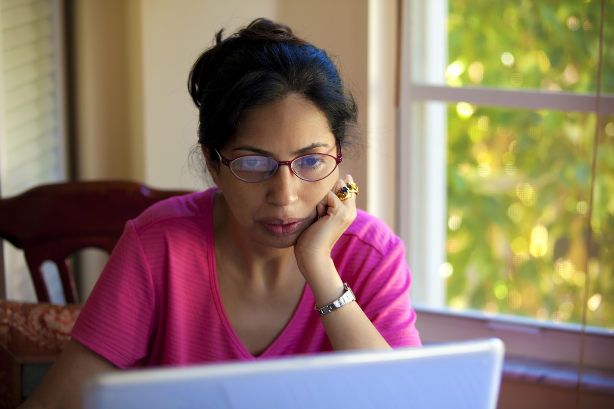 Woman reading on her laptop computer