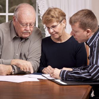 adult son and parents discussing an advanced care plan
