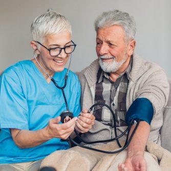 mature man having blood pressure taken